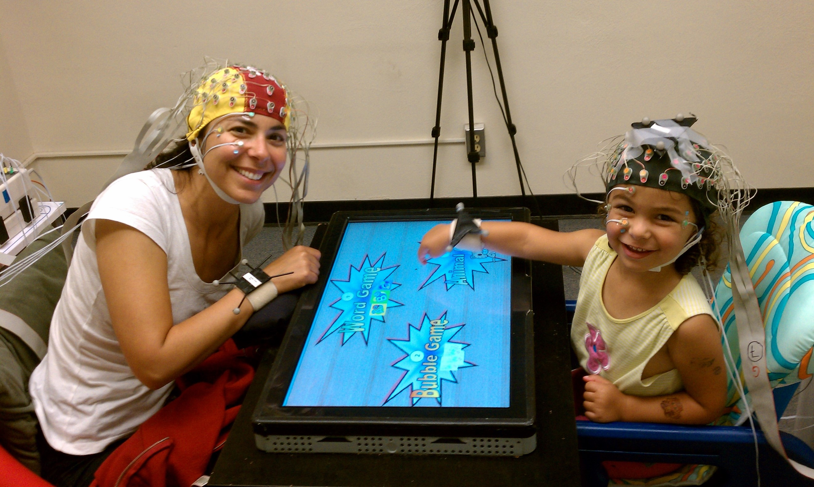 A toddler and parent play experimental games in a study of social skill learning - Cognitive Development Lab